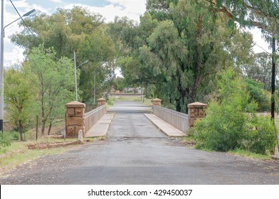 A single lane bridge leading to the station in Edenburg, a small town in the Free State Province of South Africa