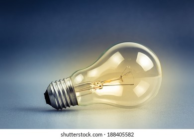 Single light bulb, still life as symbol of idea concept
