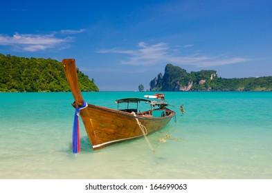 Single longtail boat on the Loh Dalum beach, Phi-Phi Don island