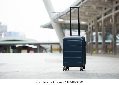 Single luggage on floor in city.