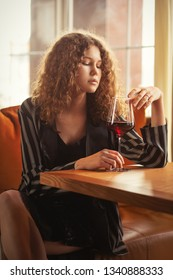 single luxury beautiful woman with wine sitting in restaurant