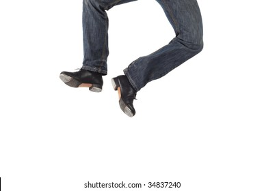 Single male tap dancer wearing jeans showing various steps in studio with white background.