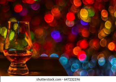 single malt tasting glass, single malt whisky in a glass, bokeh background, party night
