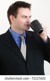 Single man in  business attire drinking coffee