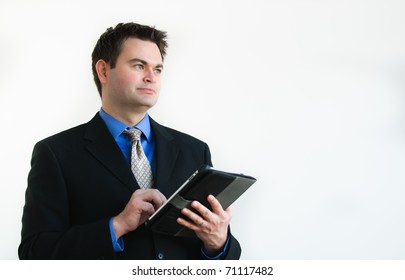 Single man in  business attire working on a tablet computer