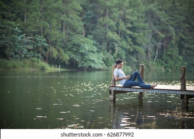Single man listen music on dock