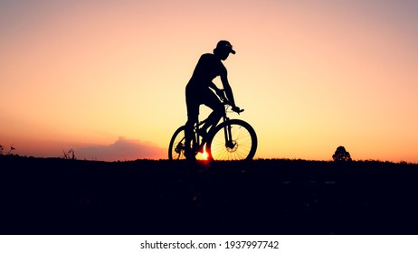 A single man is practicing his mountain bike in the evening.