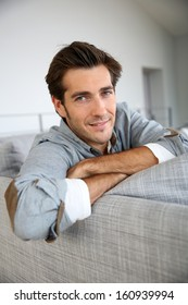 Single man relaxing in sofa at home