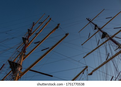 Single mast with clear sky background. Marine elements of sailboats and yachts.