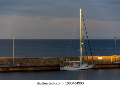 Single Masted Sailboat in a Mediterranean Port in San Marco di Castellabate, Italy