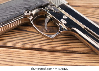 Single metal and glossy pistol on old rustic wooden weathered planks