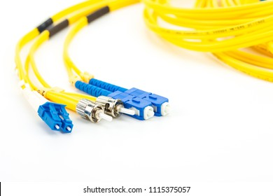 Single mode fiber optic cables patch cord with LC, SC and ST connector type on white background