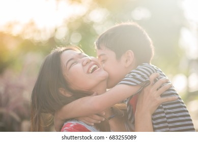 Single mom walking with son together with happy face
