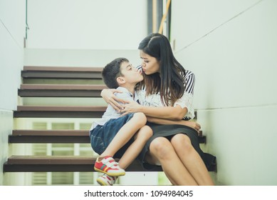 Single mother walking together on the step in the house with happy smile