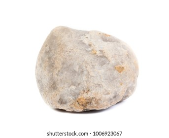 Single natural stone on white background, close-up, selective focus with shallow depth of field.