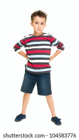 Single naughty little boy standing isolated on white