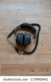 Single old vintage headphones on a wooden table