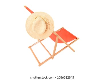 Single orange deckchair with sun hat taken in the studio on white background. Space for text.