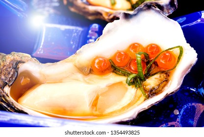 single oyster with garnish with caviar, famous seafood