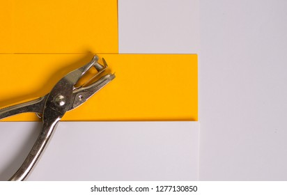Single paper hole puncher with paper background