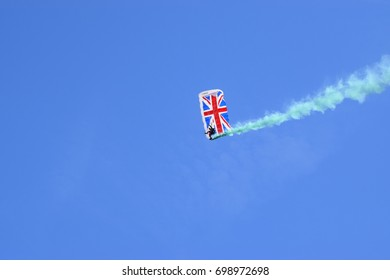 A single parachutist coming in to land - Union flag of Great Britain parachute