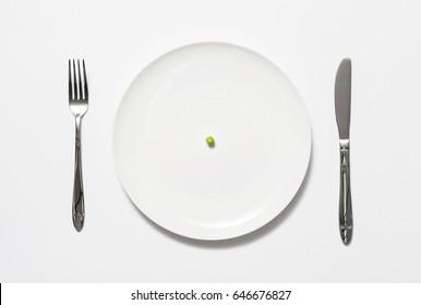 A single pea on a plate