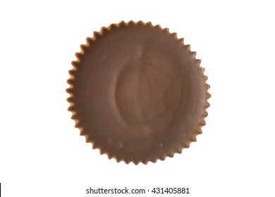 A single peanut butter cup chocolate viewed from straight overhead.