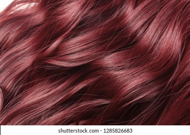Single piece clip in claret red wavy synthetic hair extensions