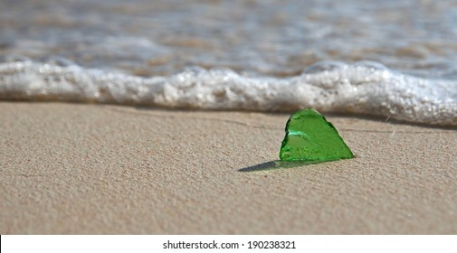 Single Piece of Green Sea Glass on the Shoreline