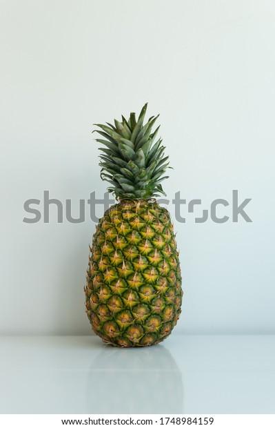 Single pineapple on white background
