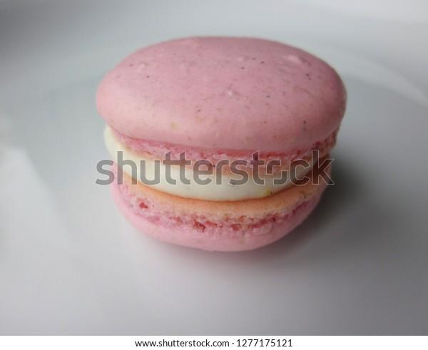 Single pink macaron with lemon cream filling