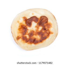 Single plain pancake isolated on a white background