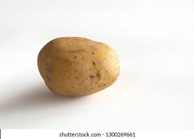 Single Potato on a white background