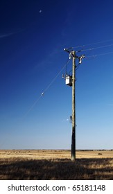 Single power pole on blue sky