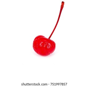 a single preserved red cherry with long stem, isolated on white background