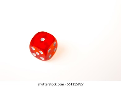 A single red die showing a one on the upper face, isolated against a white background