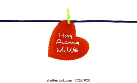 Single red love shape with text HAPPY ANNIVERSARY MY WIFE clipped on blue rope isolated on white background