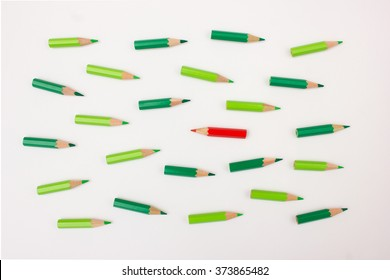 Single red pen moving against the crowd - useful image for unique business strategy / idea,  independence, opposition
