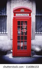 Single red phone box, London