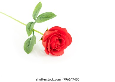 Single Red plastic fake roses on white background for Valentine's Day