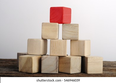 Single Red Wooden Block On Top of Blocks, Leadership Concept