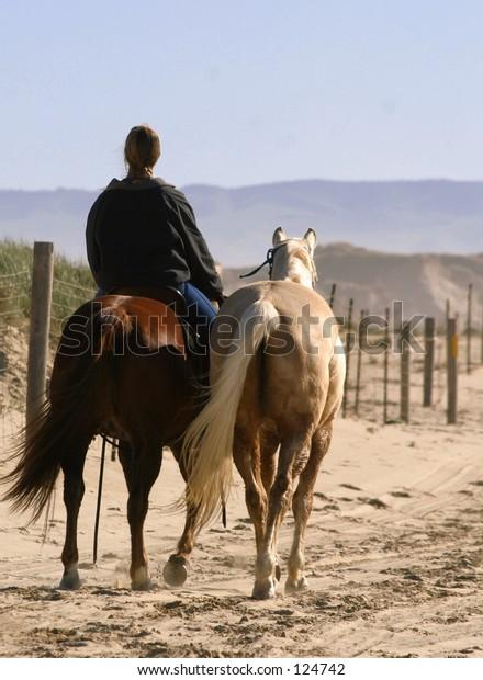 Single rider, two horses.