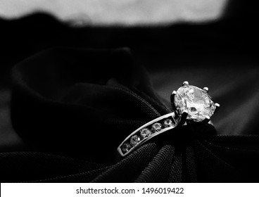 A single ring sat at an angle with black and white filter and soft focus