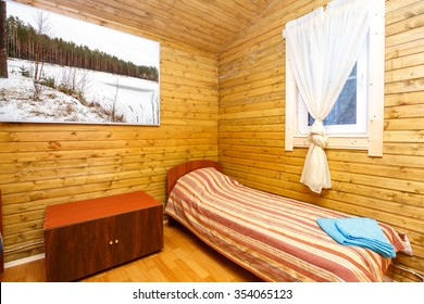Single room in hotel with big picture on the wall