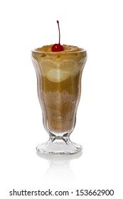 A single root beer float garnished with a cherry against a white background.
