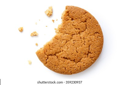Single round ginger biscuit with crumbs and bite missing, isolated on white from above.