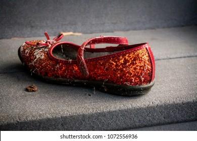 Single ruby slipper left behind on step
