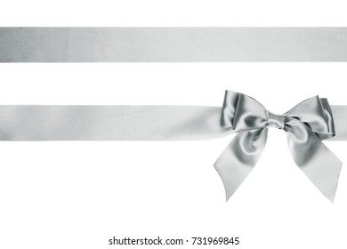 Single satin ribbon bow with tails with horizontal ribbon on white background