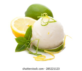 a single scoop of lemon ice cream with lemons and decoration in white background