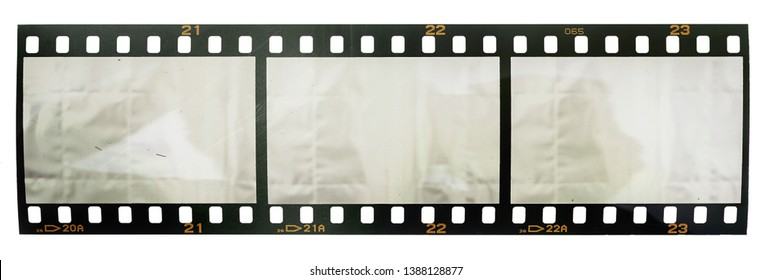 single scratched 35mm film or movie strip with three empty or blank film cells, just blend in your work to get that old film effect